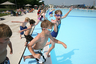 photo of portsmouth outdoor pool - kids jumping in