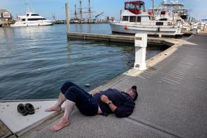 photo of swimmer on dock after marathon swim to Provincetown