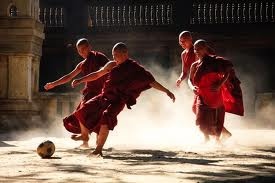 photo of monks playing soccer