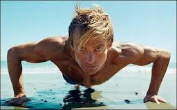 photo of surfer Laird Hamilton doing beach push-ups