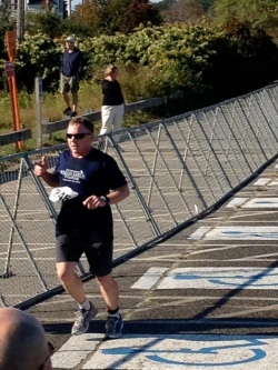 photo of M. Daly running out of transition 2 at Wallis Sands Triathlon